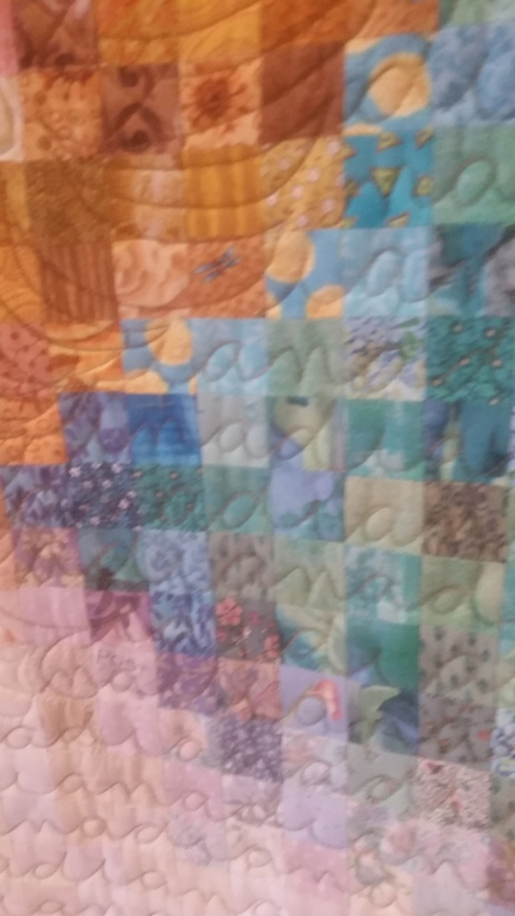 Diana's quilter, Wilma from Christian Lane Quilters, quilted her name right into the quilt